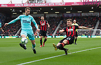 Bournemouth's Ryan Fraser (right) crosses the ball despite the attentions of Newcastle United's Florian Lejeune (left) <br /> <br /> Photographer David Horton/CameraSport<br /> <br /> The Premier League - Bournemouth v Newcastle United - Saturday 16th March 2019 - Vitality Stadium - Bournemouth<br /> <br /> World Copyright © 2019 CameraSport. All rights reserved. 43 Linden Ave. Countesthorpe. Leicester. England. LE8 5PG - Tel: +44 (0) 116 277 4147 - admin@camerasport.com - www.camerasport.com