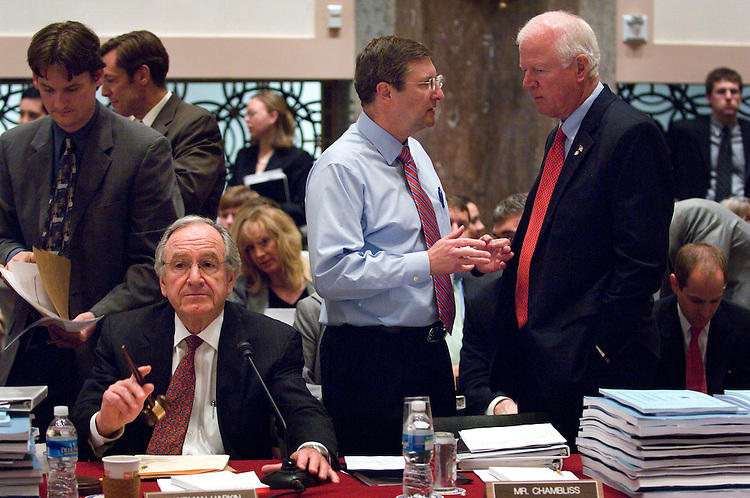 "WASHINGTON, DC - May 01: Senate Agriculture Chairman Tom Harkin, D-Iowa, get the attention of House Agriculture Chairman Collin C. Peterson, D-Minn., at the start of the House-Senate conference on the farm bill. At right is Sen. Kent Conrad, D-N.D., and Sen. Charles E. Grassley, R-Iowa. Lawmakers pushed ahead with a formal conference committee meeting Thursday on the farm bill even though several significant issues were unresolved. But despite the situation, Senate Agriculture Chairman Tom Harkin, D-Iowa, said he was confident the deal he brought to the full conference would be good enough. ""I hope we can get through this and put this puppy to bed,"" he said. (Photo by Scott J. Ferrell/Congressional Quarterly)"