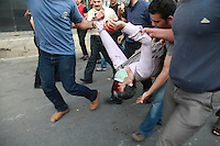 Demonstrators carry the body of one of their number who was killed during clashes on Khosh Street. Following a disputed election result, thousands of supporters of opposition candidate Mir-Hossein Mousavi took to the streets in protest.