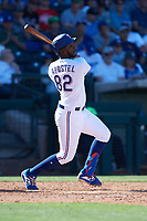 Sherten Apostel (82) of the Texas Rangers follows through on a swing during a Cactus League Spring Training game against the Los Angeles Dodgers on March 8, 2020 at Surprise Stadium in Surprise, Arizona. Rangers defeated the Dodgers 9-8. (Tracy Proffitt/Four Seam Images)