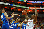 Kentucky Wildcats forward PJ Washington (25) and Louisville Cardinals center Steven Enoch (23) battled for a rebound during their game at the KFC Yum Center on Saturday Dec. 29, 2018 in Louisville, Ky.