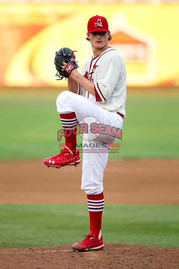 Shelby Miller (26) of the Springfield Cardinals winds up during a game against the Northwest Arkansas Naturals and the Springfield Cardinals at Hammons Field on July 30, 2011 in Springfield, Missouri. Springfield defeated Northwest Arkansas 11-5. (David Welker / Four Seam Images)