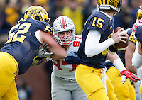 Ohio State Buckeyes defensive lineman Joey Bosa (97) fights through Michigan Wolverines linebacker Royce Jenkins-Stone (52) to get to quarterback Jake Rudock (15) during the NCAA football game at Michigan Stadium in Ann Arbor on Nov. 28, 2015. Ohio State won 42-13. (Adam Cairns / The Columbus Dispatch)