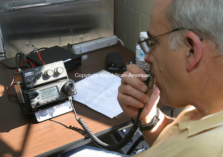 PROSPECT, CT -25 June 2005 -062505BZ02-  Craig Kalley, of Cheshire, operates a radio on the 6 meter band from the Prospect Volunteer Fire Department's emergency operations center during the American Radio Relay League's annual Field Day Saturday afternoon. <br /> Jamison C. Bazinet Photo