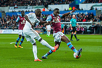 Modou Barrow of Swansea City  crosses the ball during the Barclays Premier League match between Swansea City and Aston Villa played at the Liberty Stadium, Swansea  on March the 19th 2016