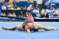 Nebraska's Grace Williams competes on the floor exercise during the semifinals of the NCAA women's gymnastics championships, Friday, April 17, 2015 in Fort Worth, Tex.(Mo Khursheed/TFV Media via AP Images)