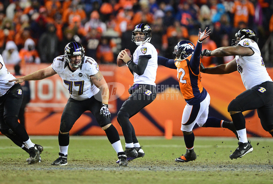 Jan 12, 2013; Denver, CO, USA; Baltimore Ravens quarterback Joe Flacco (5) against the Denver Broncos during the AFC divisional round playoff game at Sports Authority Field.  Mandatory Credit: Mark J. Rebilas-