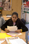 Union City CA 8th grade student reviewing her composition before submitting it in English class