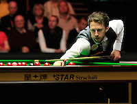 Judd Trump watches where the cue ball ends up during the Dafabet Masters Quarter Final 2 match between Judd Trump and Neil Robertson at Alexandra Palace, London, England on 15 January 2016. Photo by Liam Smith / PRiME Media Images.