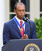 "Professional golfer Tiger Woods makes remarks after accepting the Presidential Medal of Freedom from United States President Donald J. Trump in the Rose Garden of the White House in Washington, DC on May 6, 2019.  The Presidential Medal of Freedom is an award bestowed by the President of the United States to recognize those people who have made ""an especially meritorious contribution to the security or national interests of the United States, world peace, cultural or other significant public or private endeavor.""<br /> Credit: Ron Sachs / CNP"