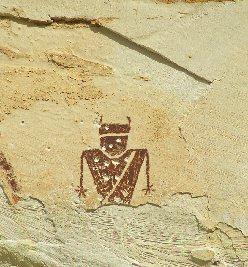Anasazi pictograph of person on canyon wall shot with bullet holes, Goblin Valley State Park, Utah.