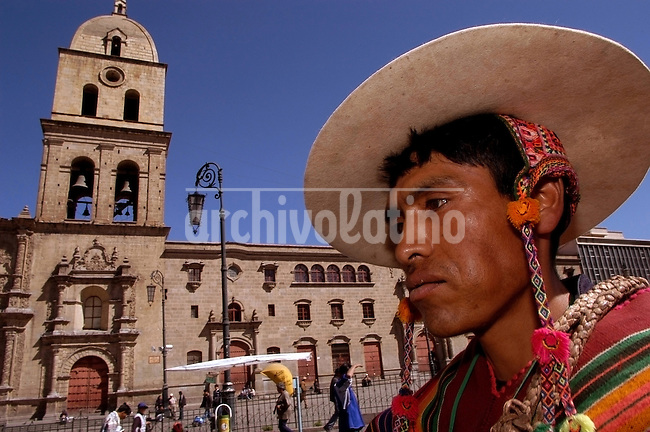 A quechua  Indian passes in front San Francisco Church in downtown La Paz. Bolivia is a country with a vast majority of Indians.