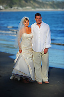 Kelli and Doug on New Brighton Beach on their wedding day May 29, 2010. (Photo by Alan Greth)