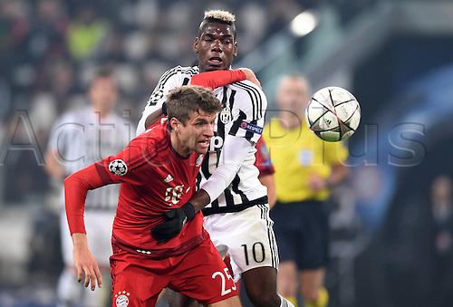 23.02.2016. Turin, Italy. UEFA Champions League football. Juventus versus Bayern Munich.  Thomas Mueller (Bayern Mun) challenges Paul Pogba ( Juventus)