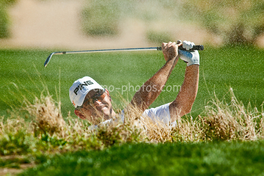 Feb 25, 2009; Marana, AZ, USA; Louis Oosthuizen (RSA)hits out of a fairway bunker on the 11th hole during the first round of the World Golf Championships-Accenture Match Play Championship at the Ritz-Carlton Golf Club, Dove Mountain.  Oosthuizen lost his match 2 and 1 to Rory McIlroy (XNI), not pictured.