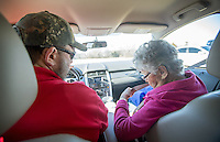 NWA Democrat-Gazette/JASON IVESTER --01/26/2015--<br /> Richard Embry with Hope Cancer Resources waits for patient Rowena Smith to fasten her seatbel in his vehicle on Monday Jan. 26, 2015, at the Highlands Oncology Center in Rogers. Embry was transporting Smith to her Holiday Island home following treatment at the center.