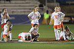 06 December 2013: Virginia players react following the penalty kick shootout. The University of California Los Angeles Bruins advanced over the University of Virginia Cavaliers in penalty kicks following a 1-1 tie at WakeMed Stadium in Cary, North Carolina in a 2013 NCAA Division I Women's College Cup semifinal match.