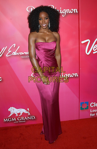"Kelly Rowland.Keep Memory Alve ""Power of Love Gala"" at MGM Grand Garden Arena, Las Vegas, Nevada, USA..February 18th, 2012.full length pink silk satin strapless dress   cleavage curly hair.CAP/ADM/MJT.© MJT/AdMedia/Capital Pictures."