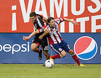 Chris Korb (22) of D.C. United fights for the ball with Ben Zemanski (21) of Chivas USA during the game at RFK Stadium in Washington, DC.  D.C. United defeated Chivas USA, 1-0.
