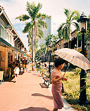 SINGAPORE, Asia, woman walking with umbrella on Bussorah street
