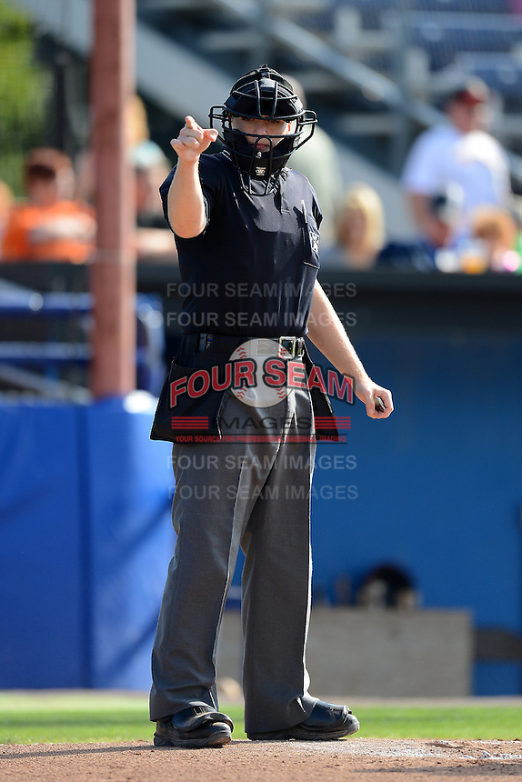 Umpire Dave Attridge makes a call during a game between the State College Spikes and Batavia Muckdogs on July 28, 2013 at Dwyer Stadium in Batavia, New York.  Batavia defeated State College 10-5.  (Mike Janes/Four Seam Images)