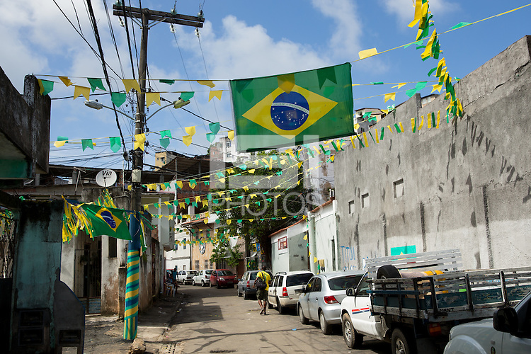 A street with Brazil flags and banners near Arena Fonte Nova