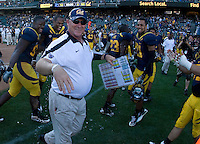 California head coach Jeff Tedford gets doused with gatorade after winning 75th victory during his CAL coach career against Presbyterian at AT&T Park in San Francisco on September 17th, 2011.  California defeated Presbyterian, 63-12.