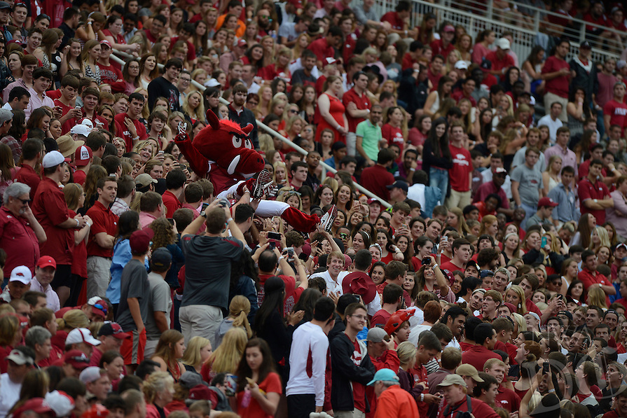 STAFF PHOTO ANTHONY REYES • @NWATONYR<br /> Arkansas mascot Big Red crowd serfs through the crowd against Nicholls State in the second quarter Saturday, Sept. 6, 2014 at Razorback Stadium in Fayetteville.