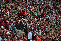 STAFF PHOTO ANTHONY REYES &bull; @NWATONYR<br /> Arkansas mascot Big Red crowd serfs through the crowd against Nicholls State in the second quarter Saturday, Sept. 6, 2014 at Razorback Stadium in Fayetteville.