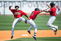 Jacob May (left), Christian Marrero (24), and Adrian Nieto (6) celebrate after Marerro drove in 2 runs in the bottom of the 13th inning for a 4-3 walk-off win over the Tennessee Smokies at Regions Field on May 4, 2015 in Birmingham, Alabama.  (Brian Westerholt/Four Seam Images)