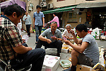 Shanghai - People's Republic of China, May 26, 2013 -- French Concession, men playing cards on a market street; people -- Photo: © HorstWagner.eu