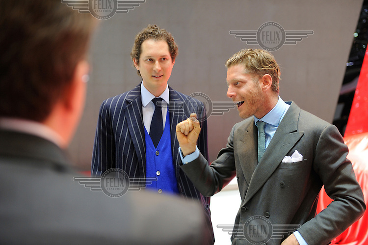 Lapo Elkann in conversation on the stand of Ferrari at the Geneva Motor Show infront of his brother, John. Along with sister, Ginevra, are the inheritors of the Agnelli family fortune, including Fiat which controls brands such as Maserati and Ferrari, amongst many others. John is chairman, Ginevra is a film director, and Lapo runs a design company.