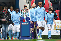 Vincent Kompany of Manchester City (2nd right) leads out the Manchester City team ahead of the Capital One Cup match between Liverpool and Manchester City at Wembley Stadium, London, England on 28 February 2016. Photo by David Horn / PRiME Media Images.
