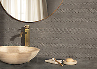 Cardigan, a waterjet and hand-cut stone mosaic, shown in tumbled Cavern, is part of the Tissé® collection for New Ravenna.