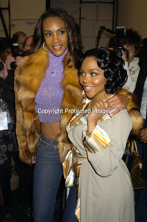 Vivica A Fox and Lil' Kim ..at The Baby Phat Fall 2005 Fashion Show on February 5, 2005 at Skylight. Photo By Robin Platzer, Twin Images