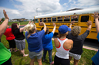 NWA Democrat-Gazette/JASON IVESTER<br /> Teachers wave as buses leave with students Friday, May 26, 2017, at Central Park Elementary School in Bentonville. Friday was the last day of the school year for Bentonville School District.