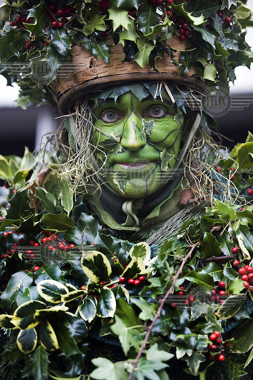 A performer dressed as the Green Man (also known as the Holly Man) from The Lions Part company - actors connected with London's Globe Theatre - acts in an annual traditional free theatre celebrating a 'wassail' celebration to herald the new year in London.