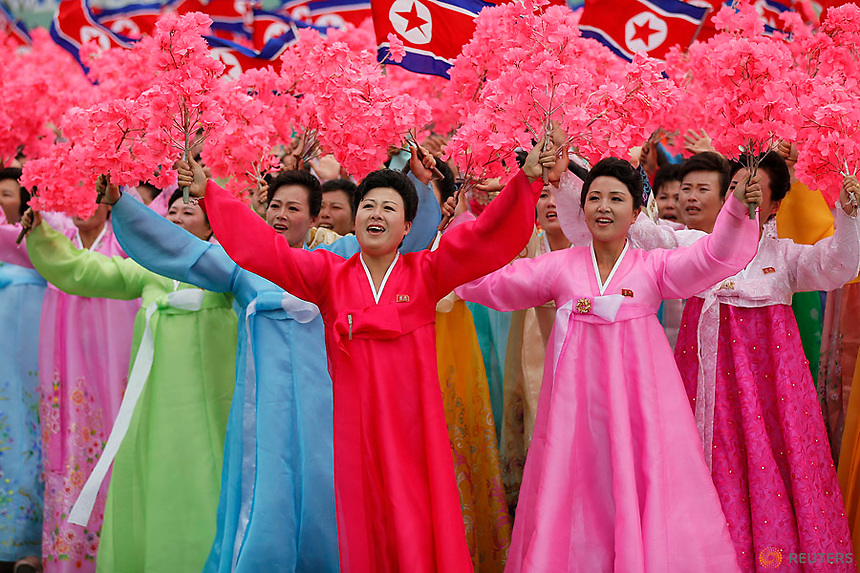 People react as they see North Korean leader Kim Jong Un during a mass rally and parade in the capital's main ceremonial square, a day after the ruling party wrapped up its first congress in 36 years by elevating him to party chairman, in Pyongyang, North Korea May 10, 2016.  REUTERS/Damir Sagolj