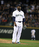 Seattle Mariners  pitcher Fernando Rodney shows his disgust as he walks in the winning run against the Oakland Athletics in the 10th inning September 13, 2014 at Safeco Field in Seattle.  The Athletics beat the Mariners 3-2 when  Mariners pitcher Fernando Rodney  walked in Coco Crisp in the 10th inning. ©2014. Jim Bryant Photo. All Rights Reserved.