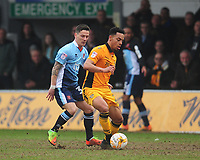 Newport County's Jazzi Barnum-Bobb under pressure from Blackpool's Ian Black<br /> <br /> Photographer Kevin Barnes/CameraSport<br /> <br /> The EFL Sky Bet League Two - Saturday 18th March 2017 - Newport County v Blackpool - Rodney Parade - Newport<br /> <br /> World Copyright &copy; 2017 CameraSport. All rights reserved. 43 Linden Ave. Countesthorpe. Leicester. England. LE8 5PG - Tel: +44 (0) 116 277 4147 - admin@camerasport.com - www.camerasport.com