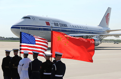 A plane carrying Chinese President Hu Jintao arrives at Andrews Air Force Base, Maryland, April 12, 2010. Jintao is attending the Nuclear Security Summit. .Credit: Kevin Dietsch / Pool via CNP