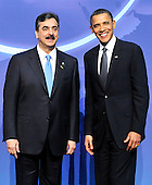 United States President Barack Obama welcomes Prime Minister Syed Yusuf Raza Gilani of Pakistan to the Nuclear Security Summit at the Washington Convention Center, Monday, April 12, 2010 in Washington, DC. .Credit: Ron Sachs / Pool via CNP