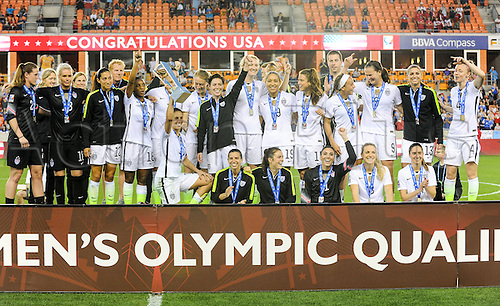 21.02.2016. Houston, TX, USA. Team USA celebrates with the championship trophy following  the Women's Olympic qualifying soccer final between Canada and USA at BBVA Compass Stadium in Houston, Texas.