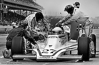 INDIANAPOLIS, IN: Janet Guthrie's crew works to resolve an engine problem in her Lightning 76 1/Offenhauser TC during the Indianapolis 500 on May 29, 1977, at the Indianapolis Motor Speedway.