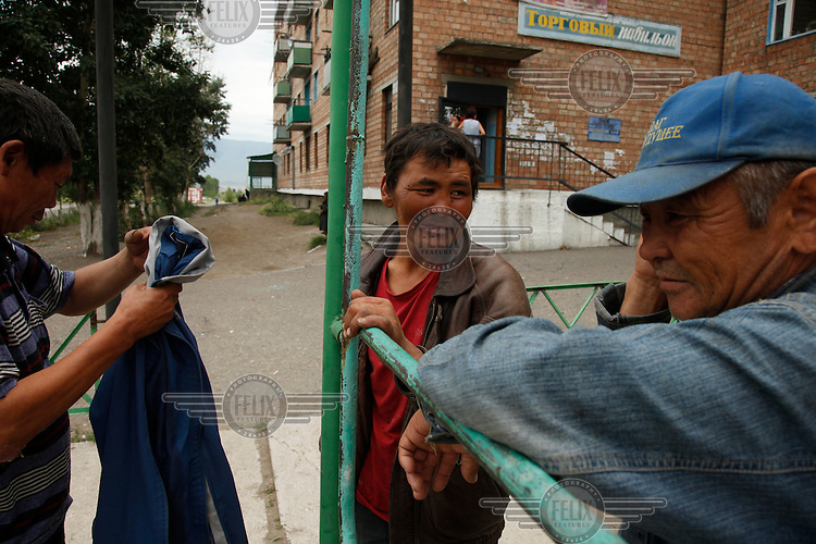 Unemployed alcohlics hang around on the street in Shaganor, a poor town in Tuva Republic, southern Siberia, Russia