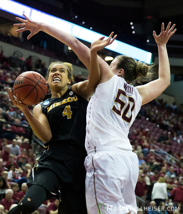 Missouri forward Cierra Porter shoots around Florida State center Chatrice White during the first half of a second-round game of the NCAA women's college basketball tournament in Tallahassee, Fla., Sunday, March 19, 2017. (AP Photo/Mark Wallheiser)