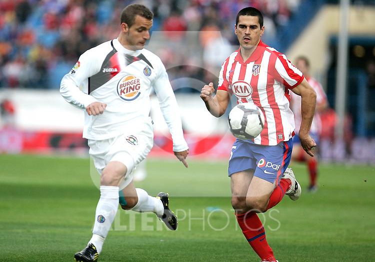 Getafe Roberto Soldado against Atletico de Madrid's Juanito during La Liga match, May 15, 2010. (ALTERPHOTOS/Alvaro Hernandez).