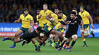Samu Kerevi of the Wallabies gets away from Richie Mo'unga of the All Blacks during the Rugby Championship match between Australia and New Zealand at Optus Stadium in Perth, Australia on August 10, 2019 . Photo: Gary Day / Frozen In Motion
