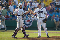 TCU catcher Bryan Holaday shakes the hand of TCU pitcher Tyler Lockwood after winning Game 11 of the NCAA Division One Men's College World Series on June 25th, 2010 at Johnny Rosenblatt Stadium in Omaha, Nebraska.  (Photo by Andrew Woolley / Four Seam Images)