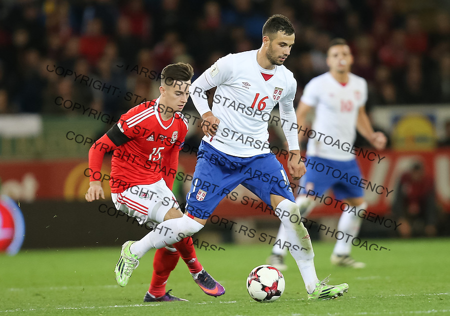(copyright &amp; photo: STARSPORT)<br /> 12.11.16 - Wales v Serbia, FIFA World Cup Qualifier 2018 - Luka Milivojevic of Serbia holds off Tom Lawrence of Wales